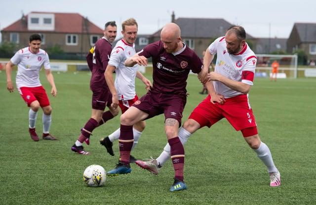Veteran Spartans defender Michael Bolochoweckyj closes down Hearts striker Liam Boyce during a pre-season friendly last month.