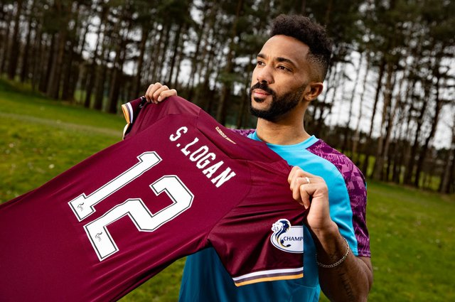 Shay Logan is uneveiled as a Hearts player after signing on loan from Aberdeen.