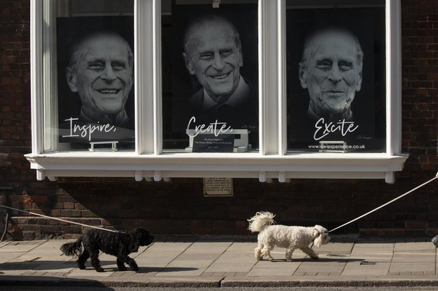 Three portraits are seen in a gallery window near Windsor Castle on April 14, 2021 in Windsor. The Queen announced the death of her husband, His Royal Highness Prince Philip, Duke of Edinburgh, who passed away peacefully on April 9 at Windsor Castle (Photo by Dan Kitwood/Getty Images).