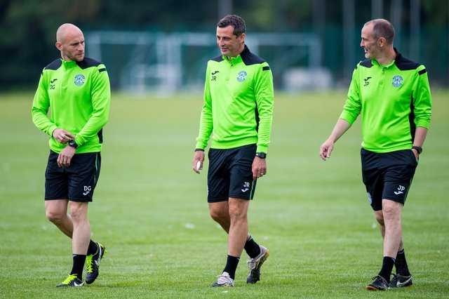 David Gray alongside manager Jack Ross and assistant John Potter at Hibs training. Picture: SNS