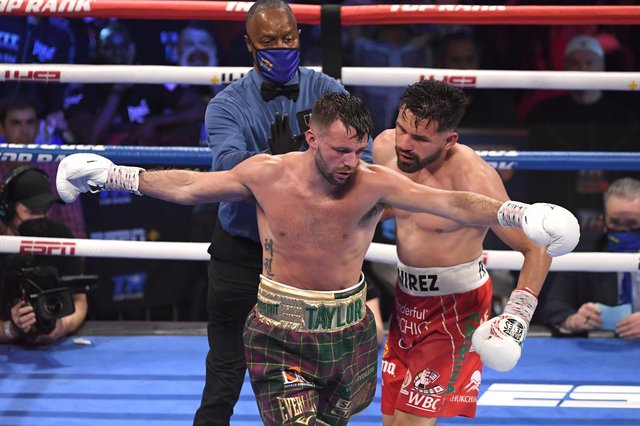 Josh Taylor and Jose Ramirez exchange words during their world unification title fight in Las Vegas. Taylor won by unanimous decision. (Photo by David Becker/Getty Images)