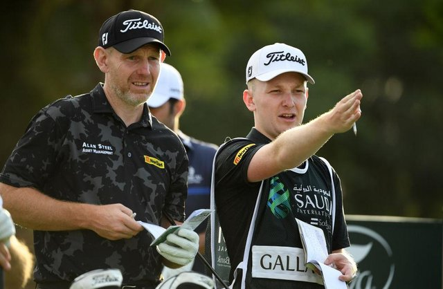 Stephen Gallacher and son/caddie Jack during the Saudi International powered by SoftBank Investment Advisers at Royal Greens Golf and Country Club in King Abdullah Economic City in February. Picture: Ross Kinnaird/Getty Images.