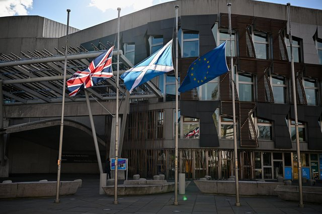 Flags fly at half mast outside the Scottish Parliament in Edinburgh to mark the death of the Duke Of Edinburgh (Photo by Jeff J Mitchell/Getty Images).