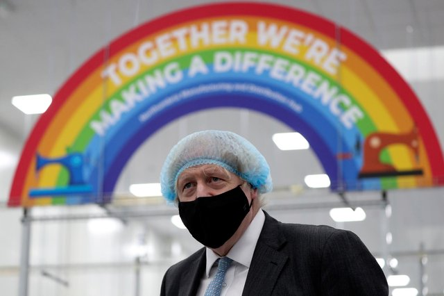 Boris Johnson wears a face mask during a visit to a PPE manufacturing facility (Picture: Scott Heppell/WPA pool/Getty Images)