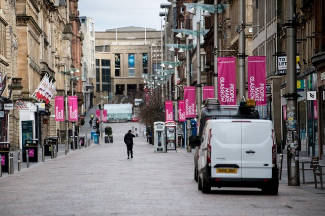 An almost empty Buchanan Street in the centre of Glasgow as people observe the spring 2020 lockdown. Non-essential stores have been forced to close for months now under tighter restrictions, hammering trade, but industry leaders are hoping for a lift from April 26. Picture: John Devlin