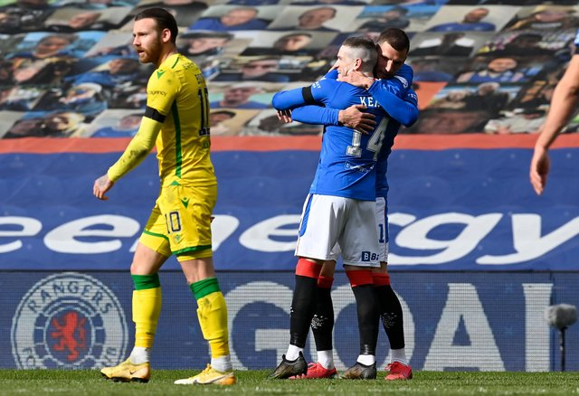 Rangers' Ryan Kent (right) celebrates what proved to be the winning goal in the Premiership match against Hibs at Ibrox. Photo by Rob Casey / SNS Group