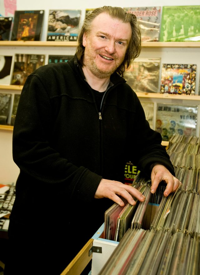 Photographer-Ian Georgeson-Owner of Avalanche records Kevin Buckle at his shop in the Grassmarket