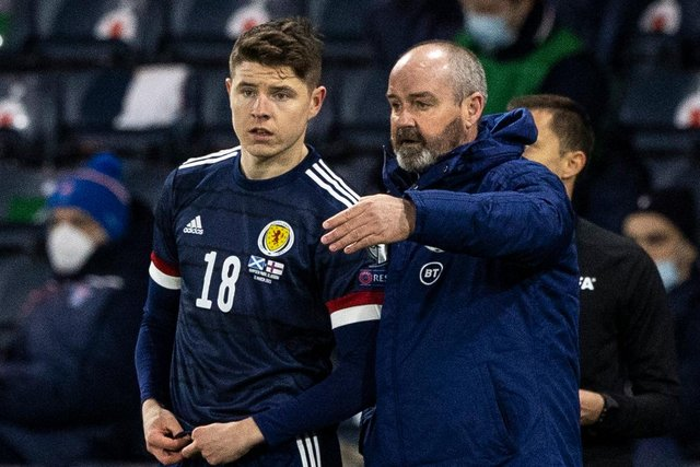 Steve Clarke speaks to Kevin Nisbet as he prepares to make his Scotland debut