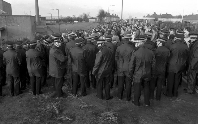 Police keep miners and the NUM picket line back outside Bilston Glen colliery during the miners strike in January 1985.