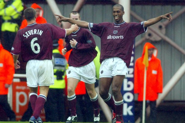 Mark de Vries celebrates scoring the second of four goals in his Edinburgh derby debut. Picture: SNS