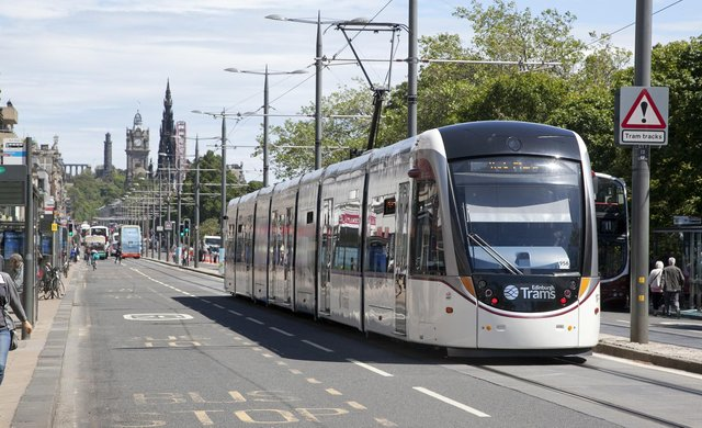 A tram on Princes Street - the council has to bear the cost of concessionary fares   Pic: Alistair Linford