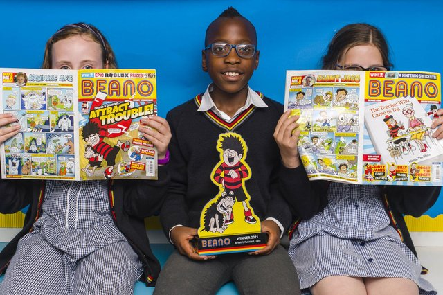 Pupils (left to right) Libby Asher, Vuyo Mdlalose and Mia Smith from class 5B at Forthill Primary school in Dundee with the trophy, as their class is unveiled as this year's winners of Beano's 'Britain's Funniest Class' national joke competition.