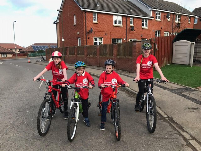 L-R: Niamh, 16,  Murray, 11, Ruari, 7,  Ava, 13, have set themselves the mammoth challenge of running, walking and cycling a combined 500km