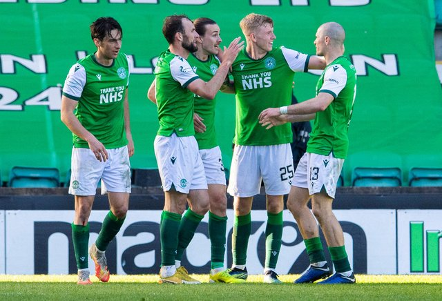 Team-mates celebrate with Hibs scorer Jackson Irvine after the Aussie put his side two ahead. Picture: SNS
