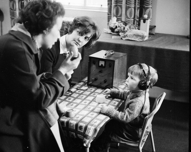 A pupil and teachers at Donaldson's School for the Deaf in February 1963.
