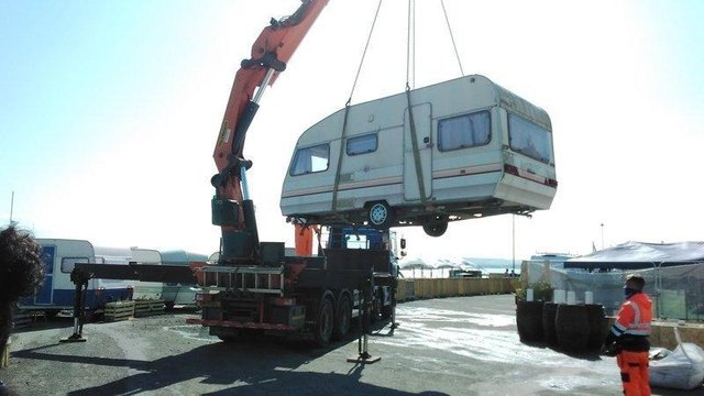 An abandoned caravan is removed from the Portobello site