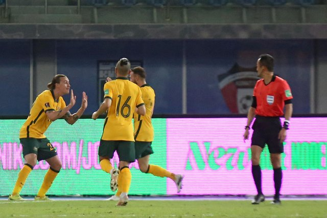 Jackson Irvine (l) celebrates after scoring the rebound from Martin Boyle's saved penalty as Australia defeated Kuwait in a World Cup qualifier at the Jaber Al-Ahmad Stadium in Kuwait City (Photo by YASSER AL-ZAYYAT/AFP via Getty Images)