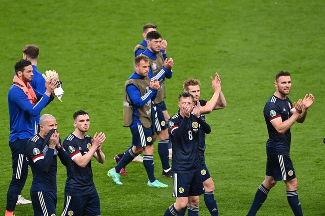 Scotland's players applaud the fans after drawing with England at Wembley.