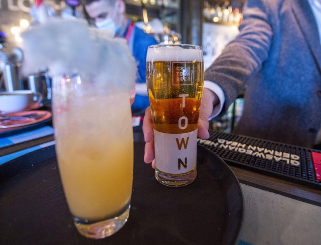Make mine a cold one - drinkers can enjoy a pint indoors from today PIC LISA FERGUSON