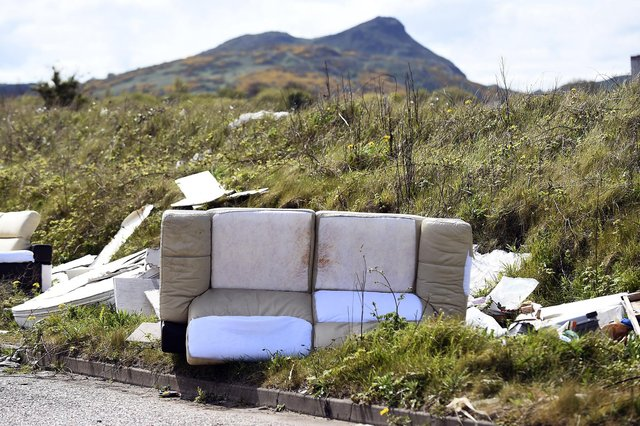 A fly-tipped sofa and other waste on Edinburgh's Marine Esplanade (Picture: Lisa Ferguson)