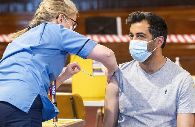 Humza Yousaf has his Pfizer vaccination jab at Caird Hall, in Dundee.