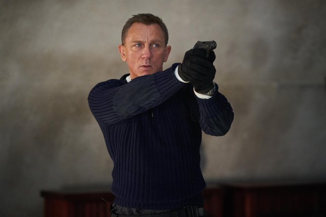 Daniel Craig playing James Bond in the new Bond film No Time To Die.