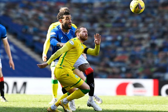 Rangers' Connor Goldson (left) battles with Hibernian's Martin Boyle during the league match between Rangers and Hibernian at Ibrox. Photo by Rob Casey / SNS Group