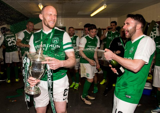 James Keatings celebrates winning the league title with David Gray in May 2017