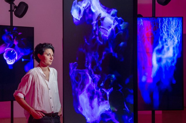 Angelica Mesiti with her exhibition 'In the Round'.