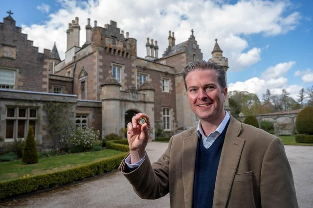 Matthew Maxwell Scott, the great, great, great, great grandson of Sir Walter Scott and trustee at Abbotsford with the new coin (Photo: Royal Mint).