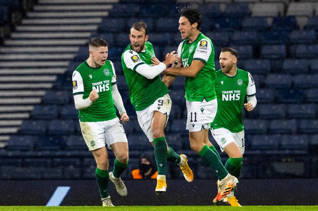 Hibs Christian Doidge celebrates with team-mates after scoring in the most recent meeting with capital rivals Hearts. Photo by Alan Harvey / SNS Group