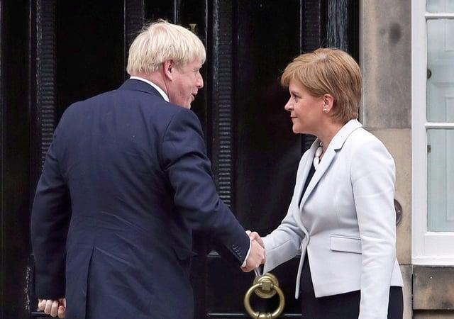 Nicola Sturgeon and Boris Johnson outside Bute House in July 2019   Photo: Jane Barlow/PA Wire
