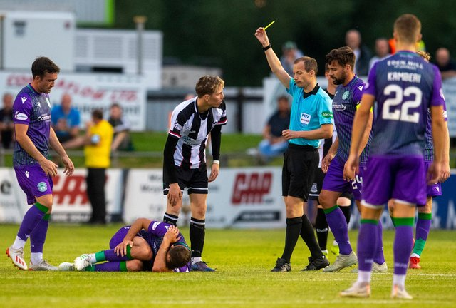 You're booked - ref Willie Collum shows Elgin City's  Kane Hester a yellow card