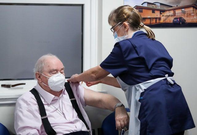 Patient receives the Oxford/AstraZeneca coronavirus vaccine, administered by Practice Nurse Ruth Davies, at Pentlands Medical Centre in Edinburgh, Scotland.