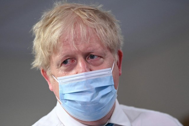 """Britain's Prime Minister Boris Johnson visits Colchester hospital in Colchester, eastern England on May 27, 2021. - Britain's government """"disastrously"""" failed the public by mishandling its coronavirus pandemic response, former top adviser Dominic Cummings told lawmakers yesterday, calling Prime Minister Boris Johnson """"unfit for the job"""". (Photo by Glyn KIRK / POOL / AFP) (Photo by GLYN KIRK/POOL/AFP via Getty Images)"""