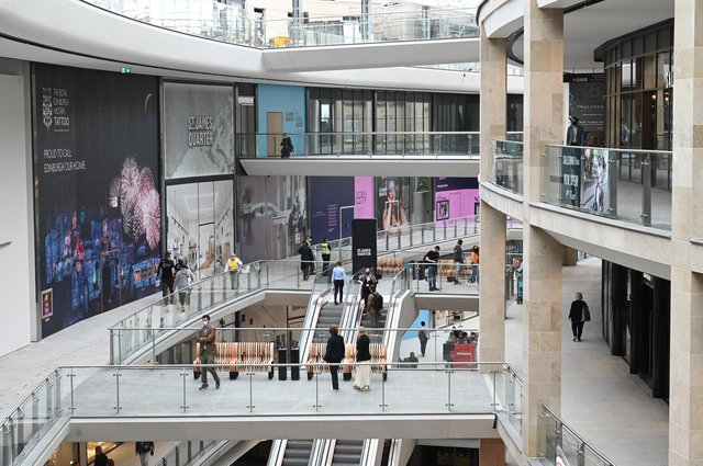 Curious shoppers explore the newly opened St James Quarter