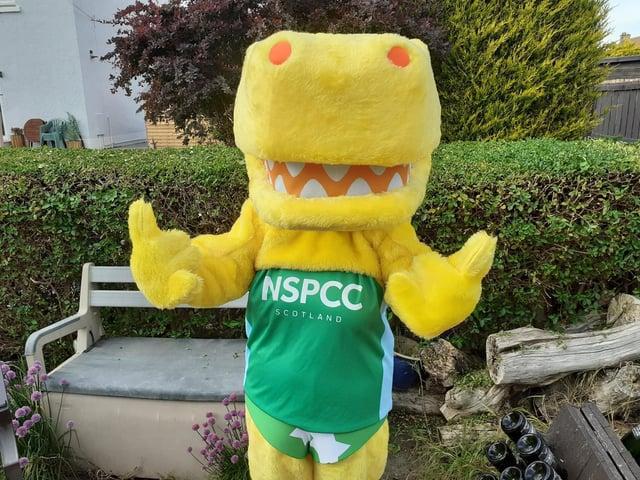 Linda Hamilton, community fundraising manager for NSPCC Scotland, dressed as Pantosaurus, NSPCC's mascot.