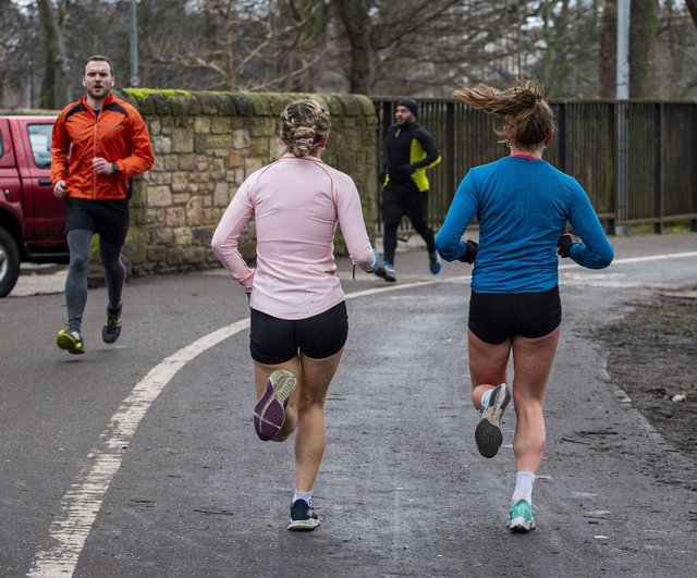 Joggers should wear a mask when running past people, experts have said.
