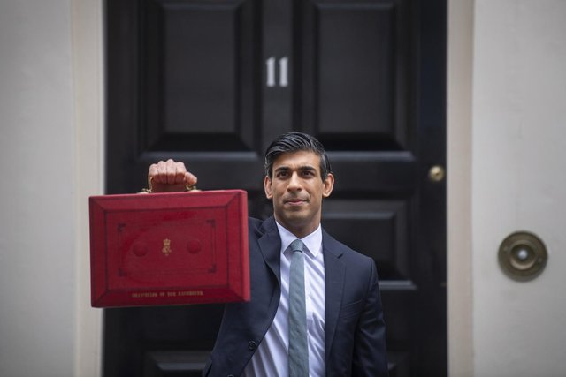 Mr Sunak confirmed the national minimum wage and the national living wage will increase for the 2021/22 financial year, during his Budget delivery. (Pic: PA)
