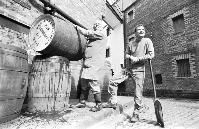 Employees Bill Edmund (with barrel) and Grahame Wood preparing to open Edinburgh's Caledonian Brewery doors to the public during Brewery Month, September 1992.