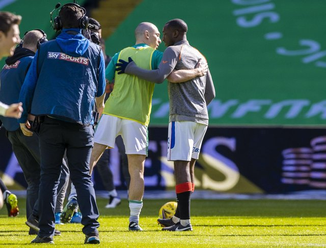 Celtic captain Scott Brown, left, embraces Rangers' Glen Kamara before the Celtic-Rangers game last Sunday (Picture: Craig Williamson/SNS Group)