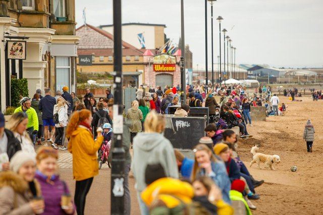 Crowds flock to Porty beach as rules change from 'stay at home' to 'stay local' for Easter weekend picture: Scott Louden