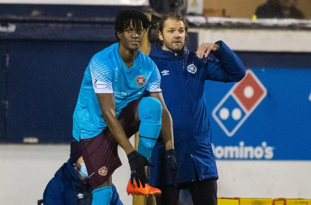 Armand Gnanduillet prepares to come on for his Hearts debut.