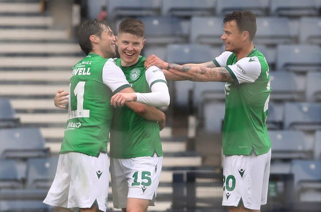 Kevin Nesbit celebrates scoring his team's opening goal during the Scottish Cup semi-final between Dundee United and Hibernian. (Photo by Ian MacNicol/Getty Images)