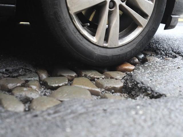 Readers have criticised Edinburgh's potholed road surfaces