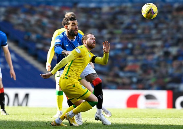 Martin Boyle of Hibs competes for the ball with Rangers' Connor Goldson