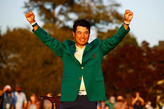 Hideki Matsuyama celebrates after receiving the Green Jacket after winning the 85th Masters at Augusta National Golf Club. Picture: Jared C. Tilton/Getty Images.