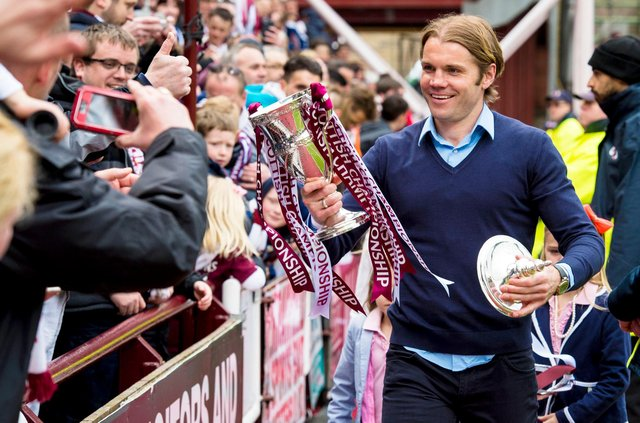 Some Hearts fans are calling on the club to leave the Championship trophy on the stand. Picture: SNS