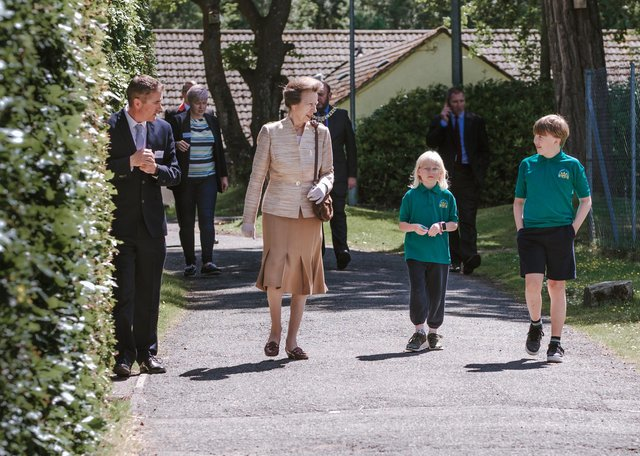Princess Anne is shown around Harmeny by two of the children