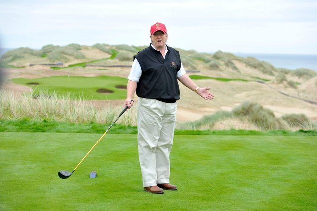Donald Trump poses for the press on the thirteenth tee of his golf course on the Menie Estate, Balmedie, Aberdeenshire
